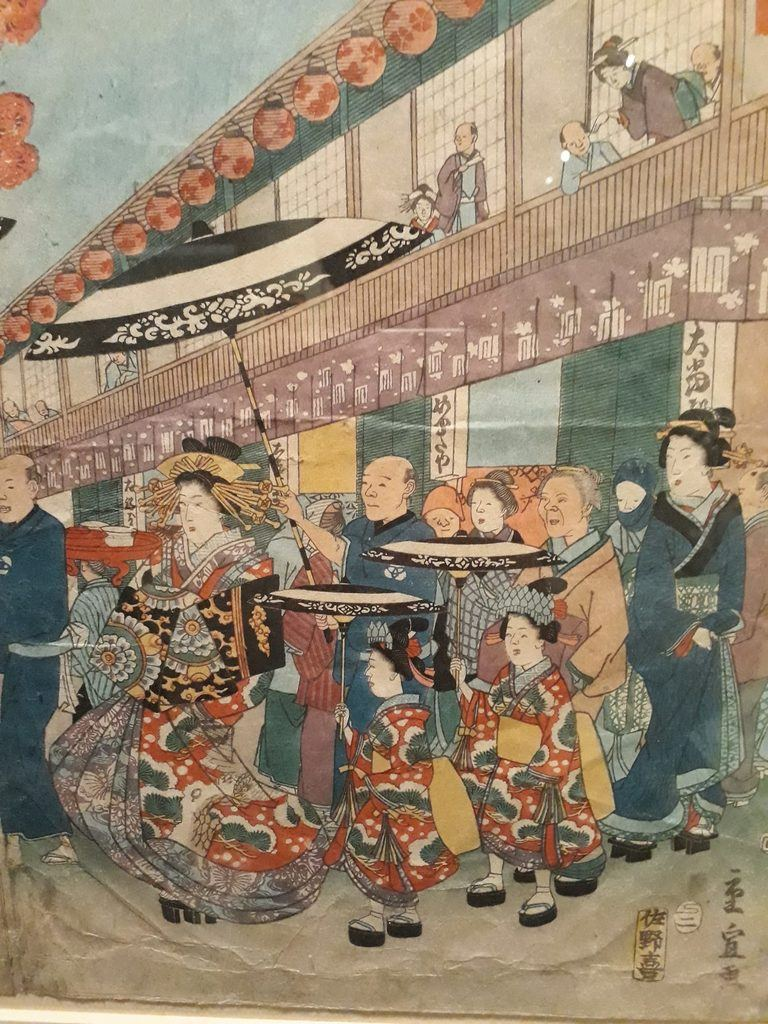 Japanese street scene showing Parade of Courtesans in 19th century.